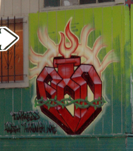 graffiti -- sacred heart: stylized heart, wrapped up and burning...