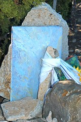 Grave with canvasses (yvern99) Tags: blue friedhof cemeteries newmexico cemetery grave graveyard memorial artist folkart cementerio 2006 painter dreams gravestone ghosttown cemitério cimetière cementerios cemitérios cimiteri elcamposanto cimetières friedhoefe cimiteris cemeteryx