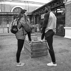 Mirroring (Wormsmeat) Tags: london londonstreetphotography street coventgarden trainers nike legs panasonic dmcgm5 1232f35 reflection symmetry blackwhite rucksack health fitness youth