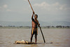 sink or swim (rick.onorato) Tags: africa ethiopia omo valley tribes tribal lake man pole