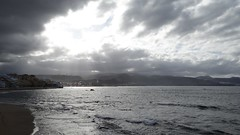 playa las canteras with very bright sunlight behind the heavy clouds (mj.aalbrecht) Tags: sunshine laspalmas canteras beach water