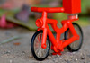 a small plastic bicycle (Gilberto Ortega) Tags: macro plastic plastico juguete toy red rojo bicicleta bicycle