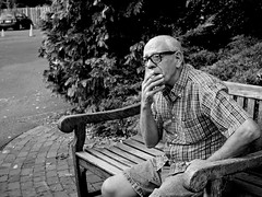 (Something Sighted) Tags: streetphotography candid smoker smokingman uneclopeaubec scènederue cigarette blackandwhite noiretblanc buckscounty newhope pennsylvania bench