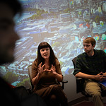 Public history graduate students present and discuss their work in D.H. Hill Library's Visualization Studio.