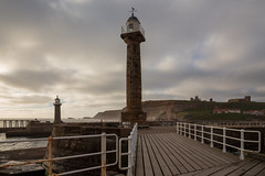 Harbour light (paul indigo) Tags: paulindigo whitby abbey bridge cliffs harbour horizontal landscape light morning pier sea town