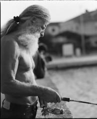 turistaszezon (.e.e.e.) Tags: man croatia fisher fishing grey sun summer analog analogue sekorc18045 mamiyarb67pros ilfordfp4plus125 tetenalultrafindeveloper120 bw blackandwhite film filmscan epsonperfection4490photoscanner midlefornat 6x7 120 whiteheaded greyheaded portrait