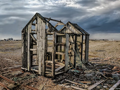 Lonely and empty, barren and wild (sagesolar) Tags: dungeness kent shed dilapidated abandonded seaside stormysky mobilephotography outdoors england shotononeplus decayed preciousjunk abandonedbuilding abandonedphotography wooden southengland pebbles structure texture bautyindecay abandonedplace forgottenplaces