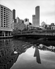 melbourne-1074-ps-w (pw-pix) Tags: bridge hotel city river buildings trees windows cranes water ripples wake reflections swirls distorted distortion sky clouds cloudy winter bw blackandwhite monochrome crowneplaza crowneplazahotel yarrariver spencerstreetbridge spencerstreet melbourne victoria australia peterwilliams pwpix wwwpwpixstudio pwpixstudio