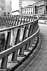 barrier (Harry Halibut) Tags: 2018©andrewpettigrew allrightsreserved imagesofsheffieldimagessheffieldarchitecture sheffieldbuildings contrastbysoftwarelaziness noiretblanc blackwhite blancoynegro blanc weiss noire schwatz bw zwart wit bianco nero branco preto sheff1804147320 ponds forge international sports centre traffic ramp barrier fence steel galvanised crash commercial street pavers pattern sheffield