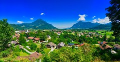 Panorama view of a Bavarian village with the Alps in Southern Germany (UweBKK (α 77 on )) Tags: panorama view scenic scenery landscape village rural bavaria bayern germany deutschland europe europa iphone mountains alps trees