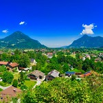 Panorama view of a Bavarian village with the Alps in Southern Germany thumbnail