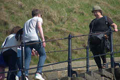 Climbing the steps at Whitby (Tony Worrall) Tags: update place location uk england north visit area attraction open stream tour country item greatbritain britain english british gb capture buy stock sell sale outside outdoors caught photo shoot shot picture captured yorkshire yorks scene scenery whitby northyorkshire resort whitbyphotos photographsofwhitby yorkshirephotos east eastern streetphotography urban candid people person picturesinthestreet photosofthestreet climb steps staircase couple