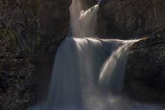 She's a beauty (Ramen Saha) Tags: glaciernationalpark stmarysfalls waterfall saintmarysfalls nationalpark montana ramensaha water rocks mist shaftoflight