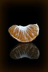 2018 Sydney: Mandarin (dominotic) Tags: 2018 food fruit mandarin citrusfruit mandarinsegment macro reflection orange blackbackground yᑌᗰᗰy sydney australia