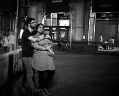 Jun 18, 2018 (pavelkhurlapov) Tags: bond couple evening hug together candid streetphotography monochrome people bike shop lights