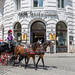 Horse carriage driving by Café Griensteidl in Vienna