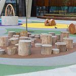 Seats made of logs at a playground thumbnail