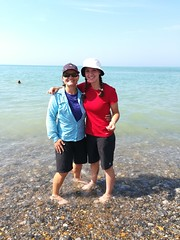 Amanda & Stephanie standing in the Atlantic Ocean just days after standing in the Pacific.