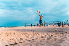 jumpserving into the light (VBuckley.com) Tags: beach beachvolleyball volleyball sand lakemichigan milwaukee bradford bradfordbeach redwhiteandblue doubles longshadows shadows sunset fun people 35mm canon glimpseofmilwaukee summer summervibes jumpserve american americana