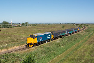 37409 Stracey Arms 30/06/18 - 37409 speeds past Stracey Arms as it heads towards Yarmouth with a non-stop summer Saturday service from Norwich.  Using the pole allowed me to go wider than normal, I think it works a treat with the large logo tractors.