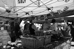 Lithuanian Kvass (Bury Gardener) Tags: streetphotography suffolk street streetcandids strangers candid candids people peoplewatching folks snaps 2018 nikond7200 nikon england eastanglia uk burystedmunds cornhill blackandwhite bw