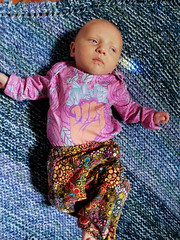 Serious (quinn.anya) Tags: eliza baby blanket fist piccadillytextilecorporation