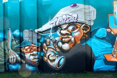 Grafiti (Step into the arena 2018) (ToJoLa) Tags: 2018 canon stepintothearena festival eindhoven colours kleuren mural grafiti muurschildering blauw blue comic figuur pet hat grumpy boos gezichtsuitdrukking face portraiit art kunst fun