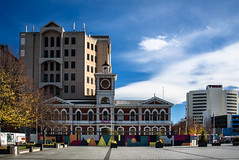 Still Earthquake Damaged (Jocey K) Tags: cathedralsquare newzealand nikond750 christchurch cbd city architecture buildings trees shadows sky clouds mural
