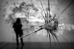 shot through the heart (bostankorkulugu) Tags: writings bullet bullethole glass broken istanbul museum turkey türkiye shot silhouette istanbulmodern art artwork modernart contemporaryart