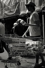 Take a dump on trump. (ianmiller6771) Tags: streetphotography streetphotographyuk streetportrait street streetlife blackandwhite whiteblack bw toiletpaper donaldtrump shoppingtrolley fujixt1 35mm reportage