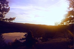Pleasuring Sunset😌 (twistling) Tags: sky sun top woods forest rock mountain memory trees water lake yellow sunrays sunset girl