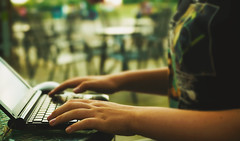 Young Girl With Laptop (dejankrsmanovic) Tags: girl people laptop notepad computer outdoors lifestyle business busy working work restaurant table seating concept conceptual study hand finger keyboard monitor screen body abstract background blurry scene candid ordinary object technology