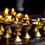Lit butter lamps at Boudhanath Stupa, Kathmandu, Nepal thumbnail