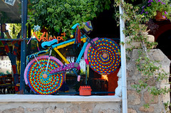 multicolored decorative bicycle in the window of a cafe (nikta_nikta) Tags: retro vintage summer beautiful bicycle bike color colorful creative decoration decorative denmark funny hippie image life multicolored nobody original outdoor road season street style symbol traditional transport transportation travel violet wheel wicker shopwindow cafe knitting crocheting hobby showcase