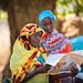 (Left) Fatna Abdurhaman discusses newborn care with Nura Mustafa