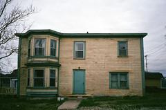 front door (.grux.) Tags: olympusxa2 film fujicolorsuperiaxtra800 grainy house empty weathered cloudy greendoor norrispoint grosmorne nationalpark newfoundland