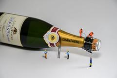 Champagne Opening (Steve, W) Tags: workmen d7500 nikon alcohol modelling models bottle champagne