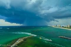 Summer storm (Krugler) Tags: hillsborolighthouse storm afternoon ocean sea sky clouds rain blue green beach florida