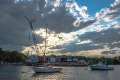 Boatyard Marblehead (armct) Tags: marblehead massachusetts usa harbour harbor motorboat sailboat yacht wharf pier shed dock crane relection sky clouds sunshine sunset silhouette