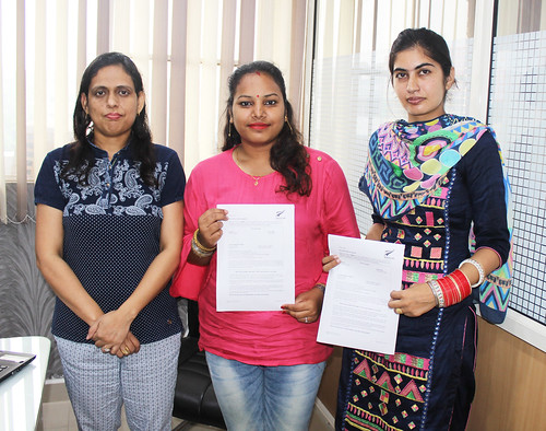 Ms. Parwinder Kaur (Director of West Highlander) handing over New Zealand Dependent Visitor Visa to Shivani Rana & Karamjeet Kaur