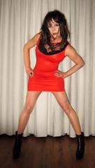 Orange is the new black.... (Irene Nyman) Tags: irenenyman dutch crossdress crossdresser irene nyman tranny tgirl transgirl boots legs blueeyes cutie babe brunette xdresser mtf lace tights pantyhose belt transvestite cute holland highheels ankleboots makeup dress minidress travestiet travestie xdress cd tv orangedress boobies posing