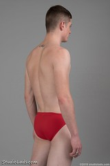 Back of teenboy standing in red speedos (StudioLads.com) Tags: male model man guy dude youth stud hunk teenboy teen boy lad eighteen 18yo pose studio photoshoot shirtless topless briefs speedo speedos swimming trunks swim swimmer swimwear red slim skinny hot horny sexy cute fit body physique back bum arse ass stand standing