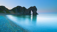 Durdle door (welshmanwandering1) Tags: sea sunrise durdledoor sky pebbles canon eos 5d dawn water seascape blue longexposure