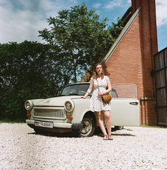 T. and Trabant 601 #classy (Boldizsár Nádi) Tags: originalphotographers photographersontumblr analogphotography 6x6 mediumformat pentacon pentaconsix tl carl zeiss jena 120 mm roll film celluloid analog analogue scanned hungary kodak portra 160 nc bokeh spring april dof green colors colour colorful portrait portraiture girl woman beauty water redhead freckles freckled redhair vintage natural original pure lenin memento park museum indoor architecture statue monument cellar building treasure budapest mementopark soviet sovjet cccp ussr communism post flektogon 50mm f4 trabant 601 trabant601