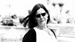 Overexposure (Neil. Moralee) Tags: neilmoralee woman lady exposure over overexposed bright brite light face portrait teignmouth devon neil moralee nikon d7200 street high highkey key black white bw bandw blackandwhite monochrome mono artistic glasses sunnies sunglasses summer seaside breeze