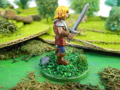 daniel2 (Giantnerdguy) Tags: mini miniature minis fantasy child children kid kids trees rocks bushes grass green fighter warrior shield sword red brown blue grey white flowers