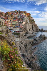 Manarola, Cinque Terre, Italy (fesign) Tags: beach buildingexterior cinqueterre cinqueterrenationalpark cliff coastline day elevatedview fishingvillage hill vertical house humansettlement idyllic italianculture italy laspezia landscape liguria liguriansea manarola mediterraneansea multicoloured outdoors photography rock scenics sea skyline touristresort tuscany vacations village water plant cactus boat vacation