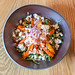 Baked pumpkin and carrots salad with quinoa, chickpea, arugula and feta cheese