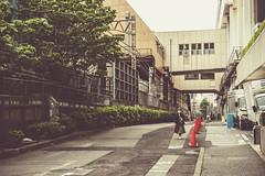 Long Road Home (Mike Kniec) Tags: japan sonya7 road building tokyo sony a7 woman walking japanese japanesewoman photosofjapan
