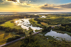 Summer over lake region called Moletai in Lithuania (spot-on.lt) Tags: sunshine shadow goldenhour plains landscape bridge vegetation moletairegion water trees cemetery cityscape aerial sun town reflection lithuania morning summer drone road lake travel forest house fields sky coast village europe sunrise inturke above architecture building city graveyard tourism woods